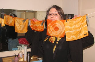 Debbie Johnson displays scarves dyed with mushrooms